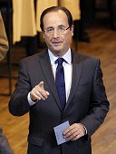 France's opposition Socialist Party candidate for the 2012 French presidential election Francois Hollande casts his ballot during the first round of...