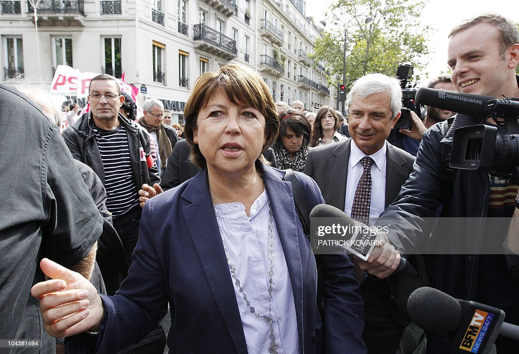 France's opposition Socialist Party (PS) leader Martine Aubry and (PS) Seine Saint-Denis general council President Claude Bartolone (R) arrive to take part to a demonstration on September 7, 2010 in Paris, during a one-day national strike action against a gouvernment pension reform bill. Strikes broke out in France for 24 hours as unions geared up for a nationwide general stoppage to protest against President Nicolas Sarkozy's plans to raise the minimum retirement age from 60 to 62.