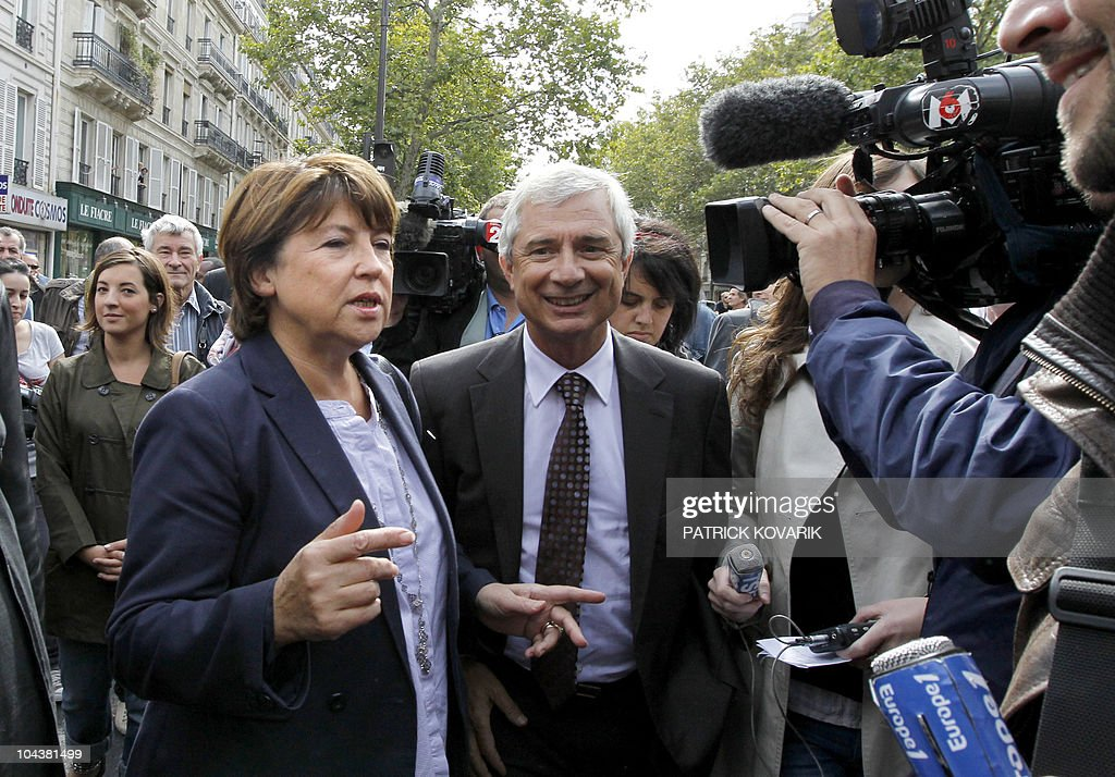 France's opposition Socialist Party (PS) leader Martine Aubry and (PS) Seine Saint-Denis general council President Claude Bartolone (R) arrive to take part to a demonstration on September 7, 2010 in Paris, during a one-day national strike action against a gouvernment pension reform bill. Strikes broke out in France for 24 hours as unions geared up for a nationwide general stoppage to protest against President Nicolas Sarkozy's plans to raise the minimum retirement age from 60 to 62. AFP PHOTO PATRICK KOVARIK