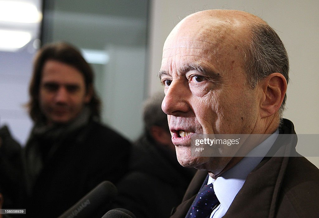 France's opposition UMP right-wing party former minister Alain Juppe addresses journalists at the party's headquarters after attending a political committee meeting on December 19, 2012 in Paris. The meeting came two days after rivals in a bitter leadership row that split France's former ruling party agreed to a new internal election after a contested first vote last month.