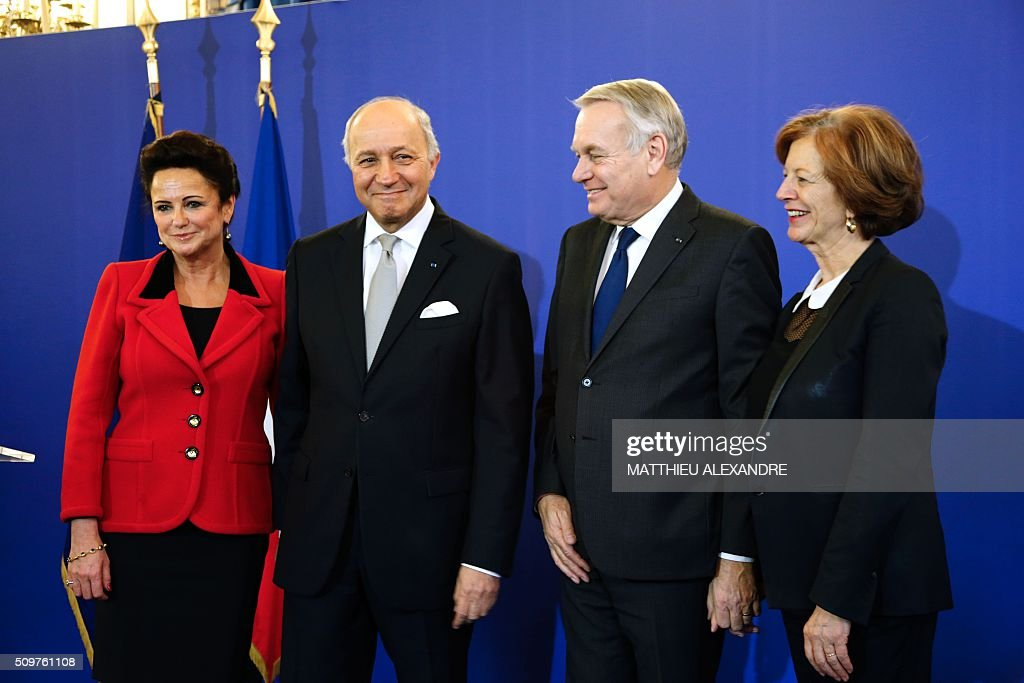 France's outgoing Foreign Minister Laurent Fabius (2ndL) and his wife Marie-France Marchand-Baylet (L) pose with newly appointed French Foreign Minister Jean-Marc Ayrault (2ndR) and his wife Brigitte Ayrault on February 12, 2016 in Paris, during the handover ceremony. French President Francois Hollande reshuffled his cabinet on February 11, 2016, naming Jean-Marc Ayrault foreign minister and adding several ecologists to government as he seeks to widen his political base ahead of a presidential poll in 2017. ALEXANDRE