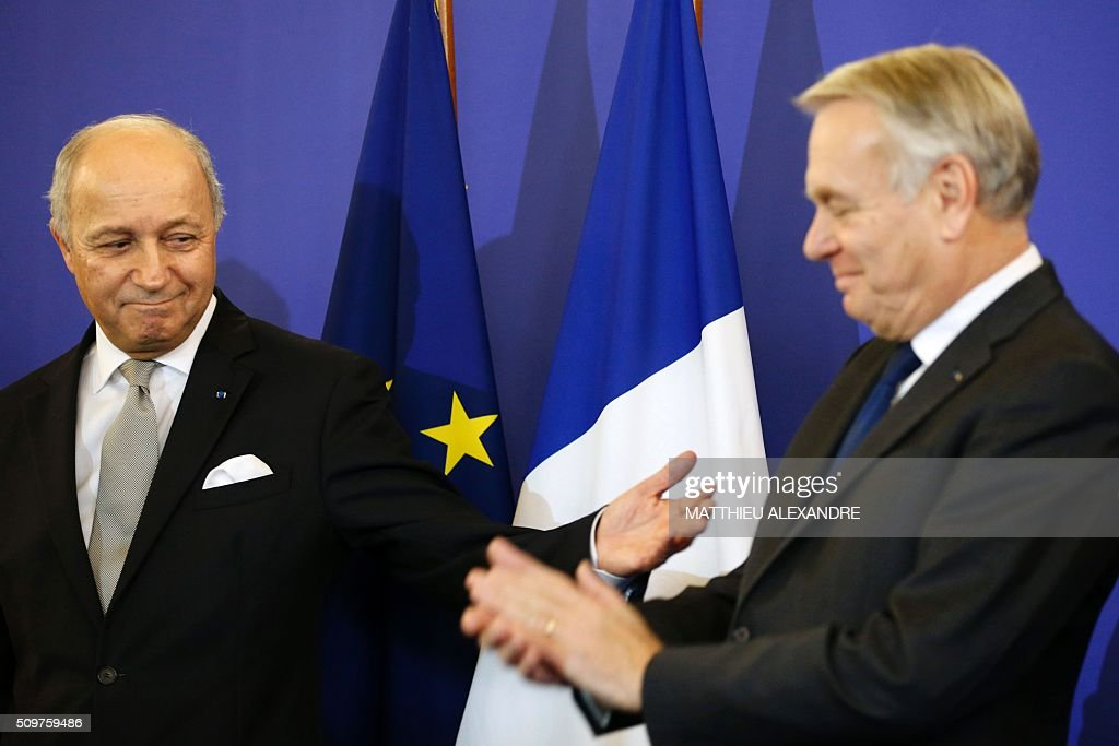 France's outgoing Foreign Minister Laurent Fabius (L) and newly appointed French Foreign Minister Jean-Marc Ayrault are pictured on February 12, 2016 in Paris, during the handover ceremony. French President Francois Hollande reshuffled his cabinet on February 11, 2016, naming Jean-Marc Ayrault foreign minister and adding several ecologists to government as he seeks to widen his political base ahead of a presidential poll in 2017. ALEXANDRE