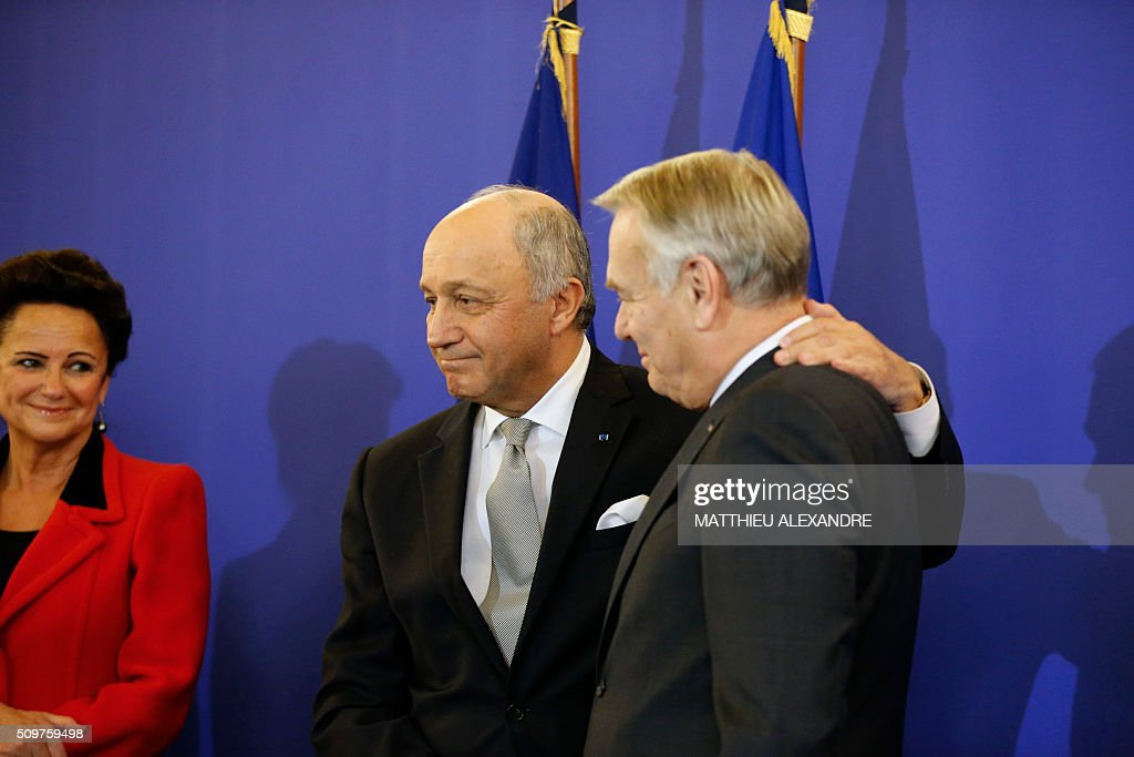 France's outgoing Foreign Minister Laurent Fabius (L) congratulates newly appointed French Foreign Minister Jean-Marc Ayrault on February 12, 2016 in Paris, during the handover ceremony. French President Francois Hollande reshuffled his cabinet on February 11, 2016, naming Jean-Marc Ayrault foreign minister and adding several ecologists to government as he seeks to widen his political base ahead of a presidential poll in 2017. ALEXANDRE