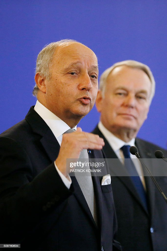 France's outgoing Foreign Minister Laurent Fabius (L) delivers a speech as newly appointed French Foreign Minister Jean-Marc Ayrault listens during the handover ceremony on February 12, 2016 in Paris. French President Francois Hollande reshuffled his cabinet on February 11, 2016, naming Jean-Marc Ayrault foreign minister and adding several ecologists to government as he seeks to widen his political base ahead of a presidential poll in 2017. / AFP / PATRICK KOVARIK