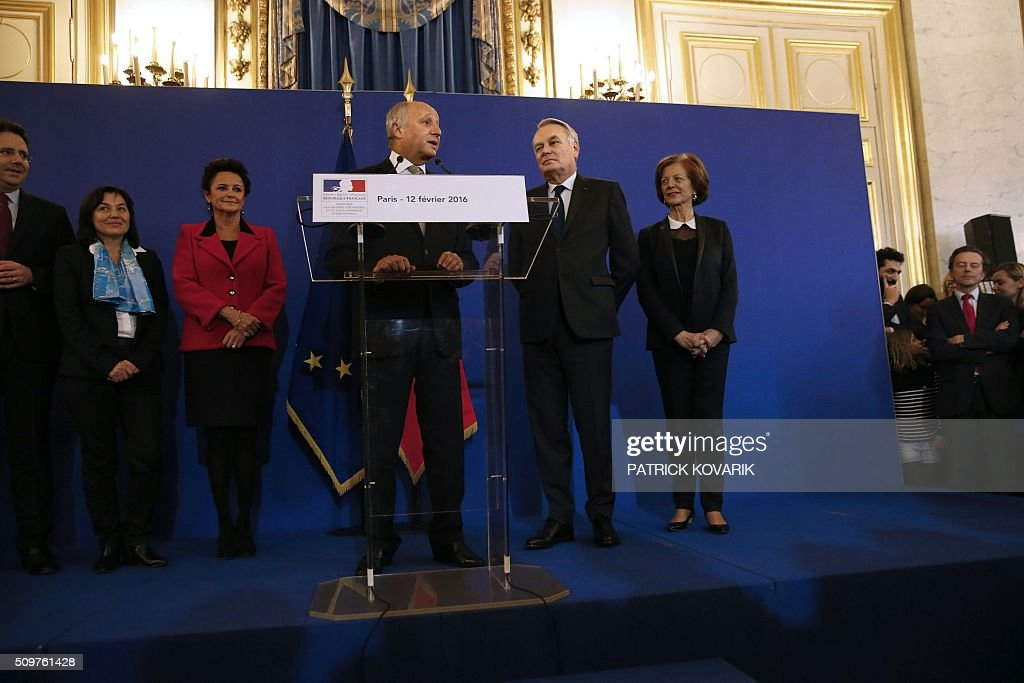 France's outgoing Foreign Minister Laurent Fabius (C) delivers a speech as newly appointed French Foreign Minister Jean-Marc Ayrault (2nd R), Ayrault's wife Brigitte (R) and Fabius' companion Marie-France Marchand-Baylet (3rd L0 listen during the handover ceremony on February 12, 2016 in Paris. French President Francois Hollande reshuffled his cabinet on February 11, 2016, naming Jean-Marc Ayrault foreign minister and adding several ecologists to government as he seeks to widen his political base ahead of a presidential poll in 2017. / AFP / PATRICK KOVARIK