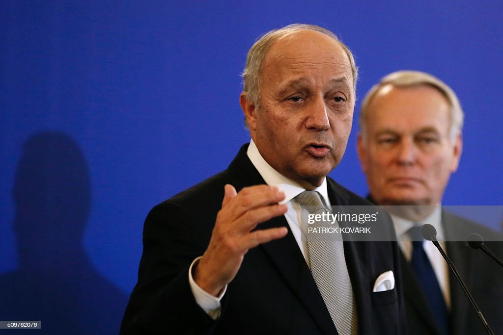 France's outgoing Foreign Minister Laurent Fabius (Front) delivers a speech as newly appointed French Foreign Minister Jean-Marc Ayrault listens during the handover ceremony on February 12, 2016 in Paris. French President Francois Hollande reshuffled his cabinet on February 11, 2016, naming Jean-Marc Ayrault foreign minister and adding several ecologists to government as he seeks to widen his political base ahead of a presidential poll in 2017. / AFP / PATRICK KOVARIK