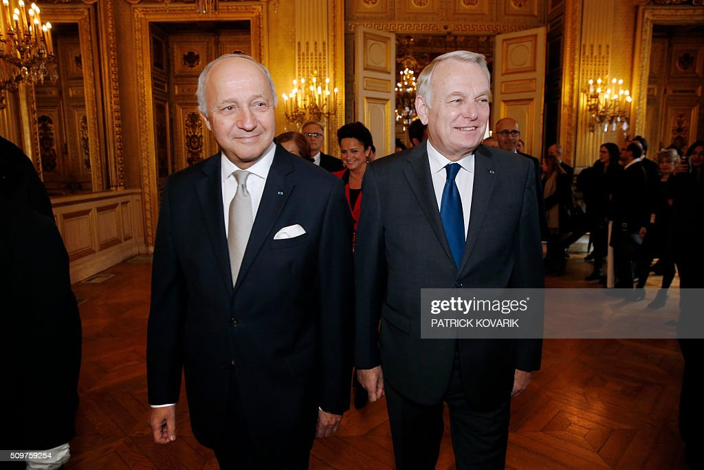 France's outgoing French Foreign Minister Laurent Fabius (L)and newly appointed French Foreign Minister Jean-Marc Ayrault arrive for the handover ceremony on February 12, 2016 in Paris. French President Francois Hollande reshuffled his cabinet on February 11, 2016, naming Jean-Marc Ayrault foreign minister and adding several ecologists to government as he seeks to widen his political base ahead of a presidential poll in 2017. / AFP / PATRICK KOVARIK