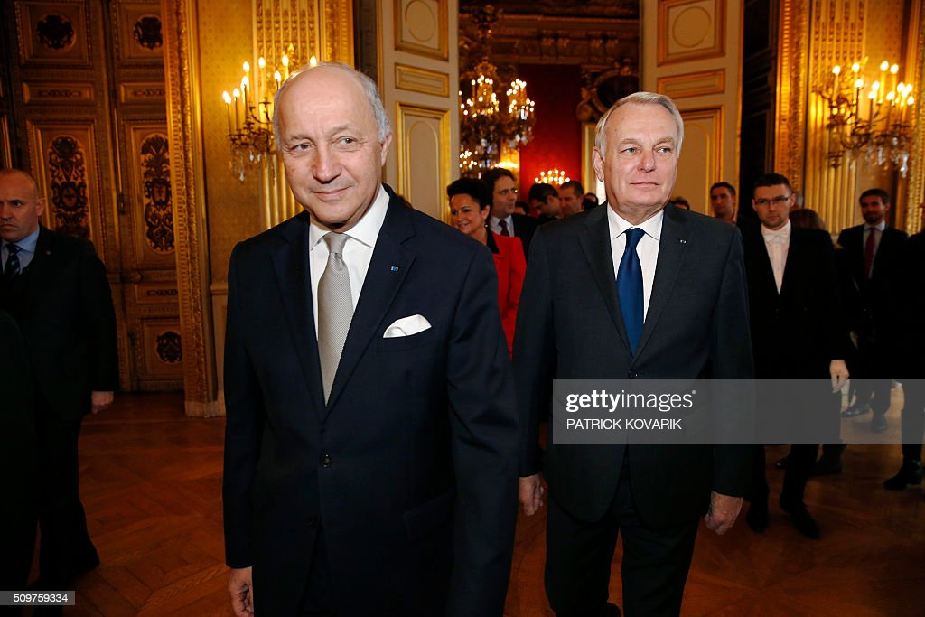 France's outgoing French Foreign Minister Laurent Fabius (L) and newly appointed French Foreign Minister Jean-Marc Ayrault arrive for the handover ceremony on February 12, 2016 in Paris. French President Francois Hollande reshuffled his cabinet on February 11, 2016, naming Jean-Marc Ayrault foreign minister and adding several ecologists to government as he seeks to widen his political base ahead of a presidential poll in 2017. / AFP / PATRICK KOVARIK