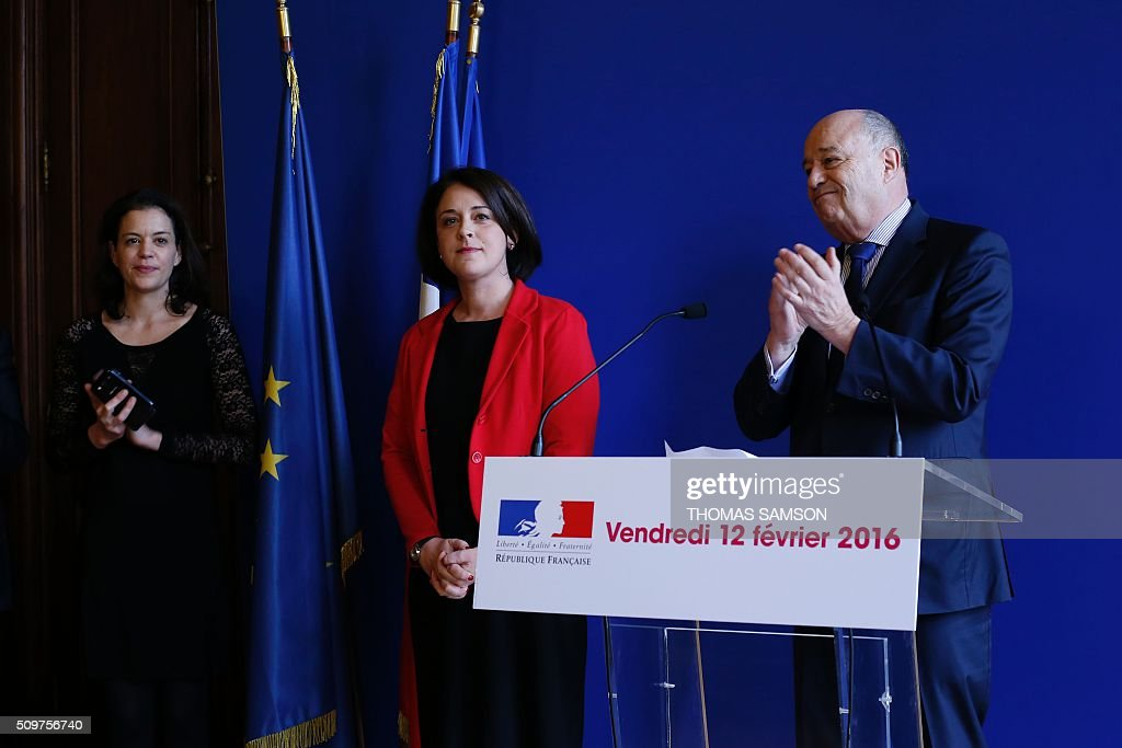 France's outgoing Housing and Territories minister Sylvia Pinel (2ndR) listens to Jean-Michel Baylet (R), newly appointed minister for Minister of Town and Country Planning, Rural Affairs and Local Authorities, on February 12, 2016 in Paris, during the handover ceremony. French President Francois Hollande reshuffled his cabinet on February 11, 2016, naming Jean-Marc Ayrault foreign minister and adding several ecologists to government as he seeks to widen his political base ahead of a presidential poll in 2017. SAMSON