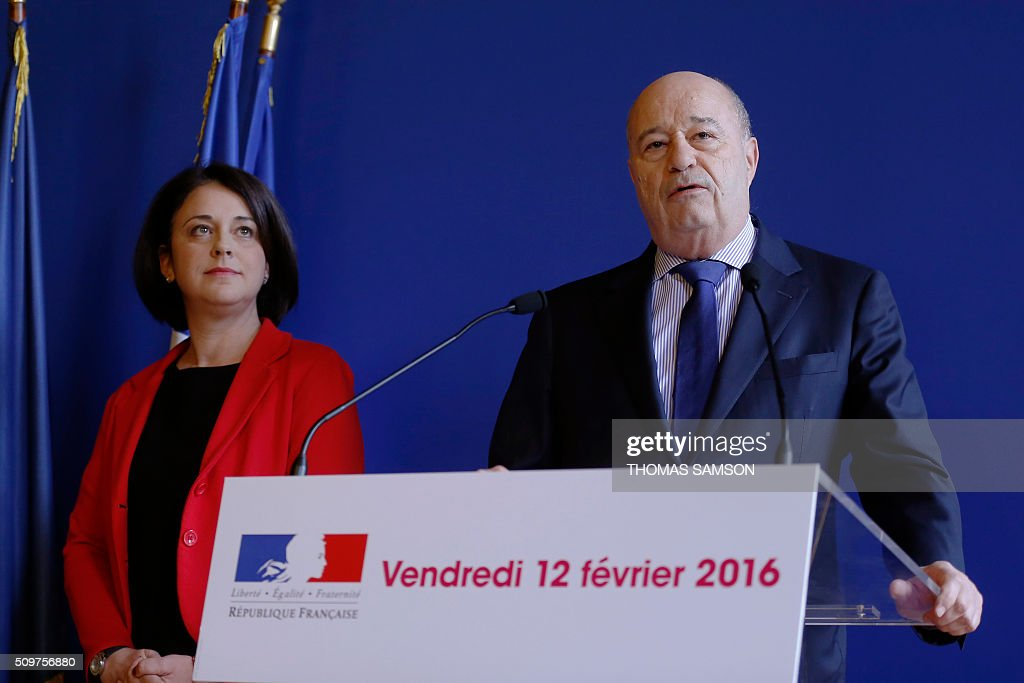 France's outgoing Housing and Territories minister Sylvia Pinel (L) listens to Jean-Michel Baylet (R), newly appointed minister for Minister of Town and Country Planning, Rural Affairs and Local Authorities, on February 12, 2016 in Paris, during the handover ceremony. French President Francois Hollande reshuffled his cabinet on February 11, 2016, naming Jean-Marc Ayrault foreign minister and adding several ecologists to government as he seeks to widen his political base ahead of a presidential poll in 2017. SAMSON