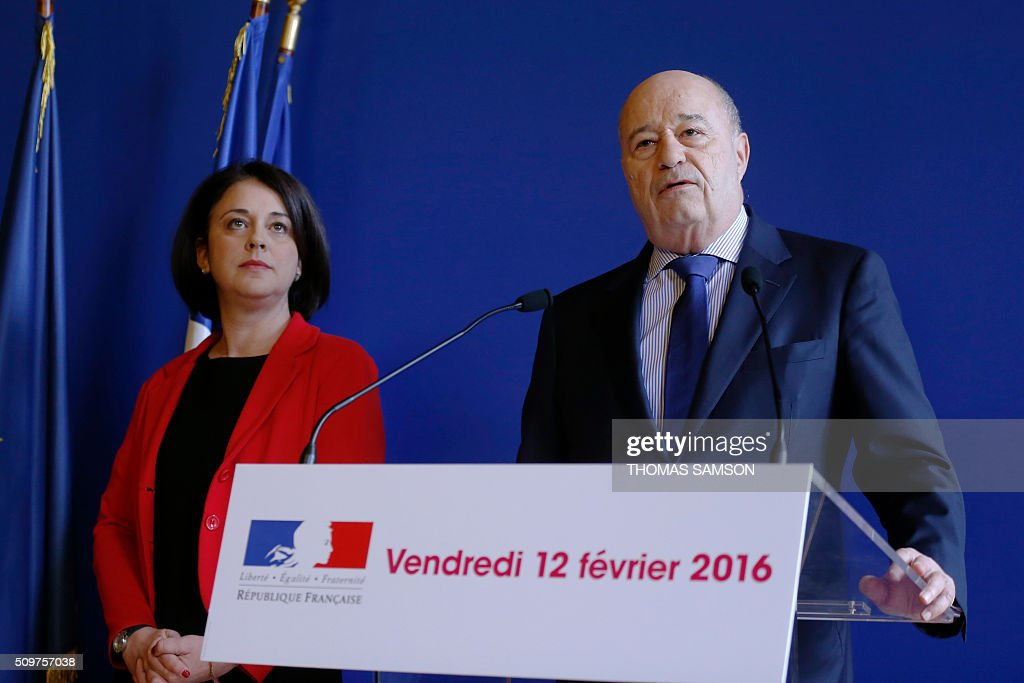 France's outgoing Housing and Territories minister Sylvia Pinel (L) listens to Jean-Michel Baylet, newly appointed minister for Minister of Town and Country Planning, Rural Affairs and Local Authorities, on February 12, 2016 in Paris, during the handover ceremony. French President Francois Hollande reshuffled his cabinet on February 11, 2016, naming Jean-Marc Ayrault foreign minister and adding several ecologists to government as he seeks to widen his political base ahead of a presidential poll in 2017. SAMSON