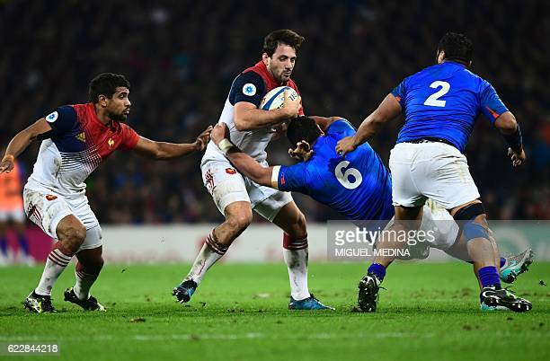TOPSHOT France's outside center Remi Lamerat vies with Samoa's blindside flanker Alafoti Faosiliva during the friendly rugby test match between...