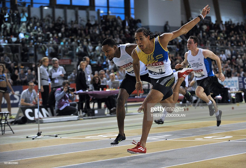 France's Pascal Martineot Lagarde (C) crosses the finish line to win ahead of France's Dimitri Bacou (L) in the men's 60m hurdles contest at the 2013 French Indoor Athletics championships on February 16, 2013 in Aubiere, central France. ZOCCOLAN