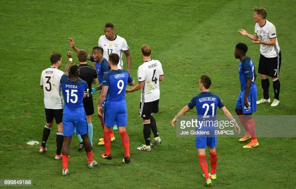 France's Patrice Evra appeals to match referee Nicola Rizzoli for a penalty