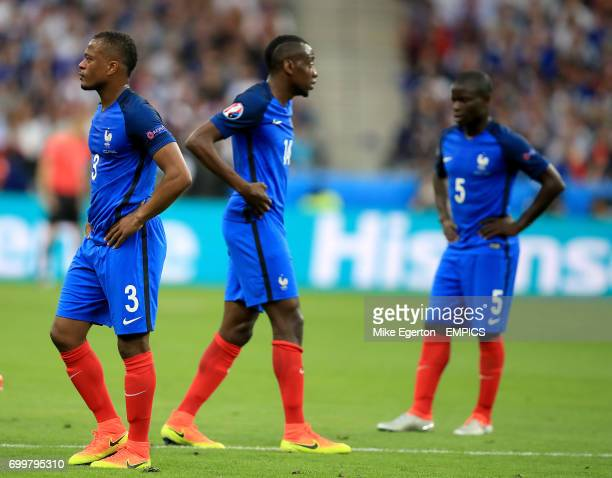 France's Patrice Evra France's Blaise Matuidi and France's N'Golo Kante appear dejected
