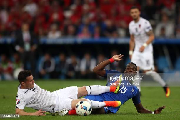 France's Paul Pogba and Albania's Taulant Xhaka battle for the ball