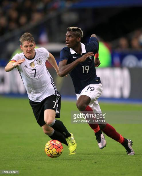 France's Paul Pogba and Germany's Bastian Schweinsteiger
