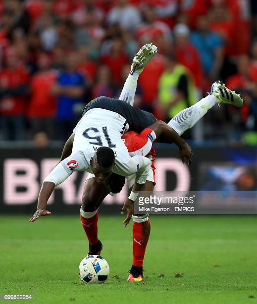 France's Paul Pogba goes head first over Switzerland's Breel Embolo as they battle for the ball
