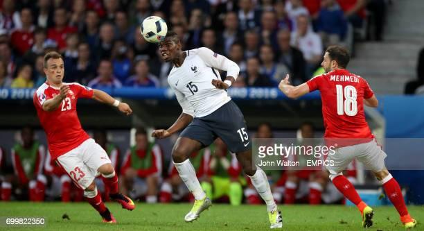 France's Paul Pogba in action with Switzerland's Xherdan Shaqiri and Admir Mehmedi