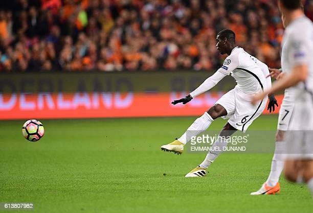 TOPSHOT France's Paul Pogba shoots to score a goal during the FIFA World Cup 2018 qualifying football match Netherlands vs France on October 10 2016...