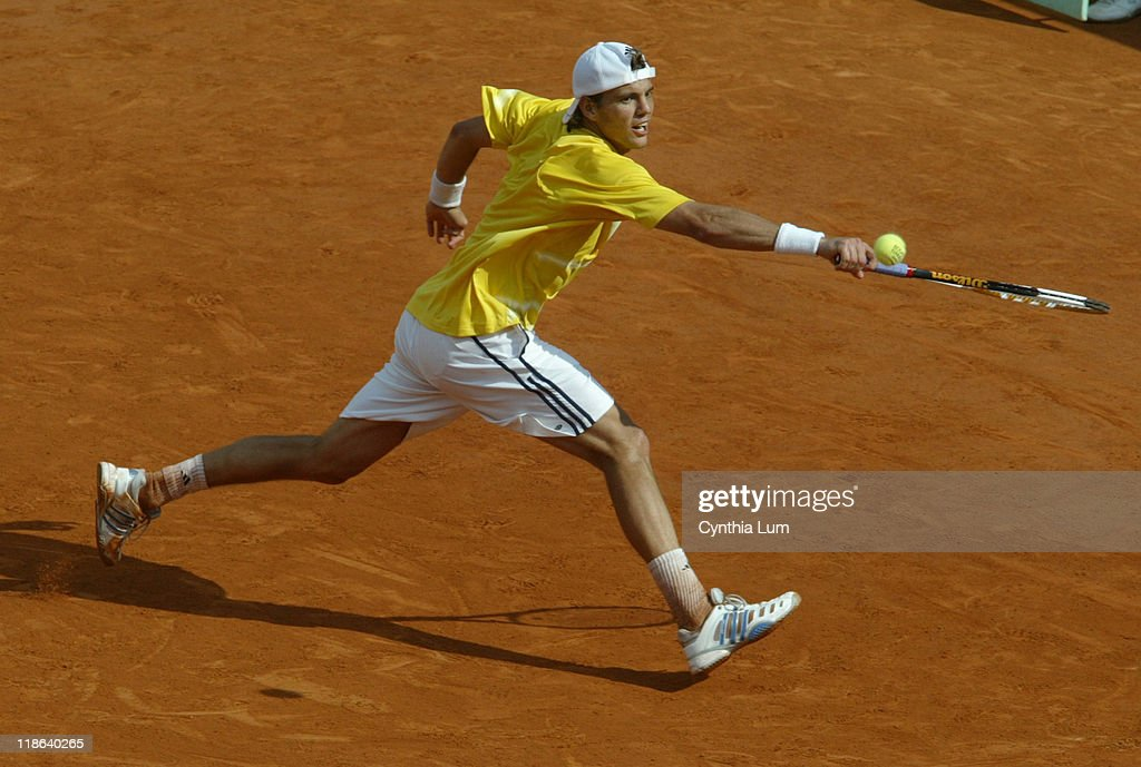 France's Paul-Henri Mathieu lunges to hit a return versus Spain's Rafael Nadal during the third round of the 2006 French Open men's singles, Paris. Nadal won 5-7, 6-4, 6-4, 6-4.