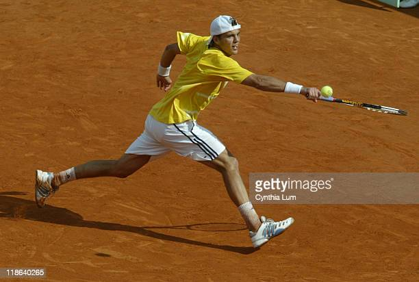 France's PaulHenri Mathieu lunges to hit a return versus Spain's Rafael Nadal during the third round of the 2006 French Open men's singles Paris...