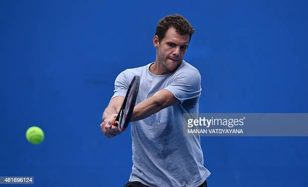 France's PaulHenri Mathieu plays a shot during a practice session ahead of the 2015 Australian Open tennis tournament in Melbourne on January 18 2015...