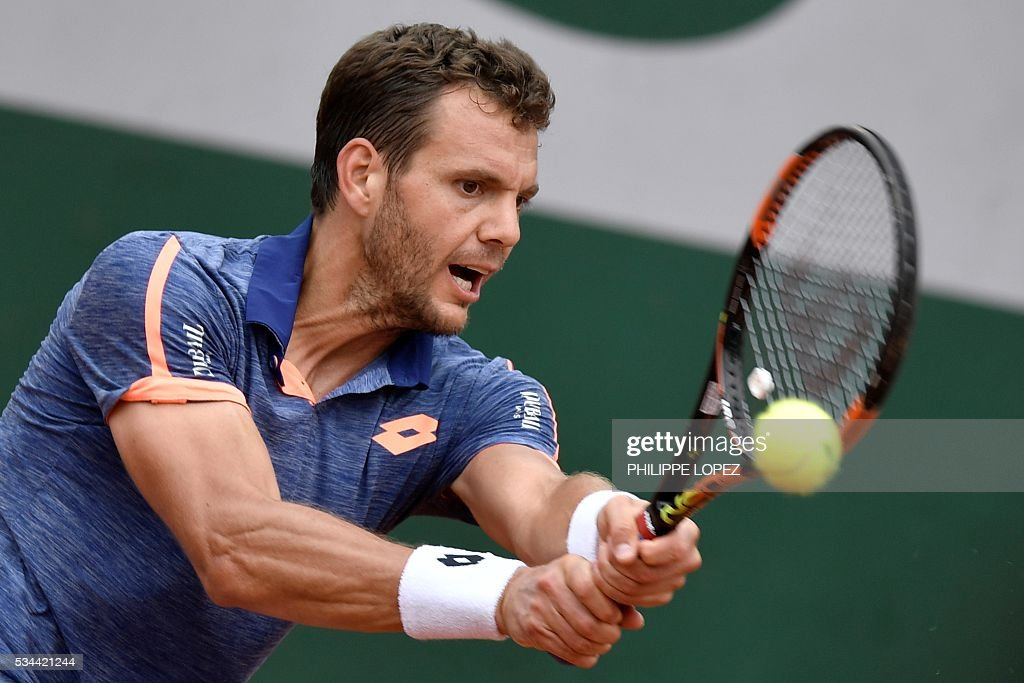 France's Paul-Henri Mathieu returns the ball Spain's Roberto Bautista Agut during their men's second round match at the Roland Garros 2016 French Tennis Open in Paris on May 26, 2016. / AFP / PHILIPPE