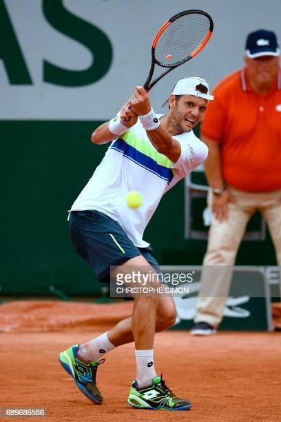 France's PaulHenri Mathieu returns the ball to Belgium's David Goffin during their tennis match at the Roland Garros 2017 French Open on May 29 2017...