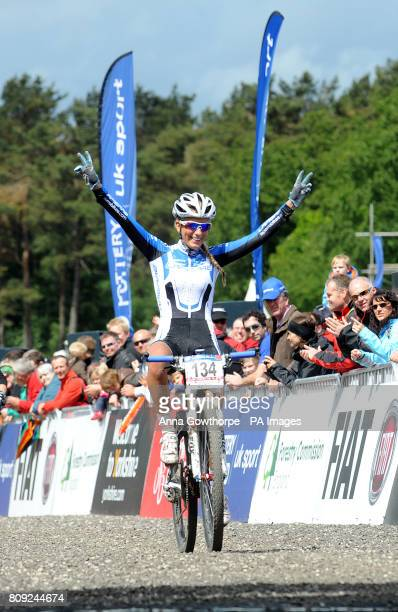 France's Pauline Ferrand Prevot celebrates winning the Women's Under 23 Elite Cross Country Olympic 2 Mountain Bike World Cup event at Dalby Forest...
