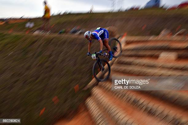 France's Pauline Ferrand Prevot competes in the cycling mountain bike women's crosscountry race of the Rio 2016 Olympic Games at the Mountain Bike...