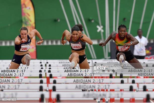 TOPSHOT France's Pauline Lett Canada's Ashlea Elaine Maddex and Burkina Faso's Marthe Koala compete in the women's 100m hurdles at the Felix...