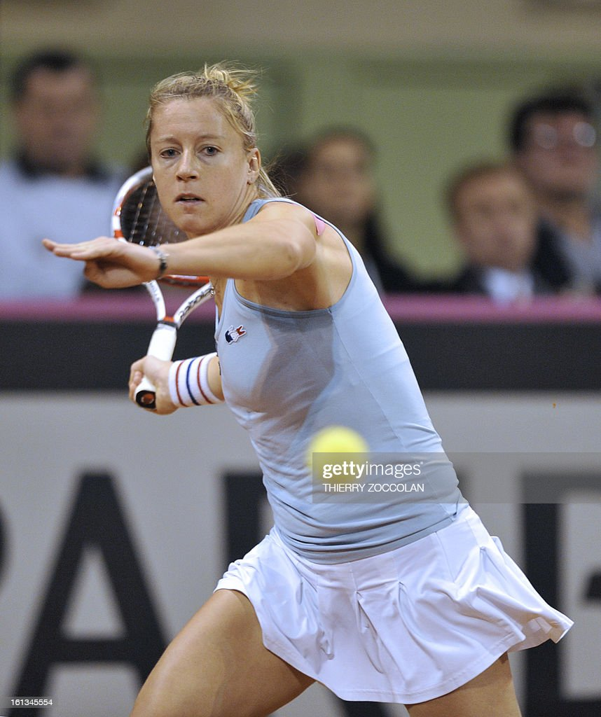 France's Pauline Parmentier returns the ball to Germany's Julia Goerges on February 10, 2013 during the third match of the Fed Cup 2013 between France and Germany at the Beaublanc courts in Limoges. Germany completed a 3-0 win over France in a Fed Cup World Group II tie today when Julia Goerges defeated Pauline Parmentier 6-4, 6-2.
