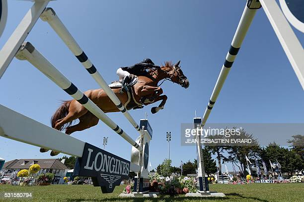 TOPSHOT France's Penelope Leprevost riding Flora de Mariposa competes during the International Jumping of France equestrian event on May 15 2016 in...