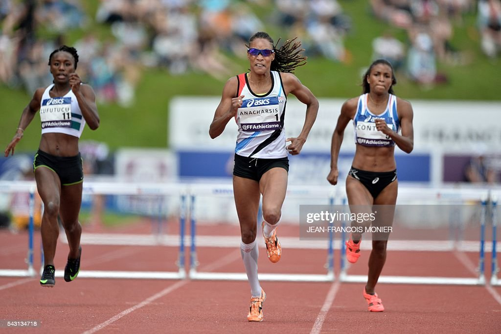 France's Phara Anacharsis (M) competes for the Women's 400m hurdles final next to France's Anais Lufutucu (L) and France's Maeva Contion (R) during the French Athletics Elite championships on June 26, 2016 at the Lac de Maine stadium in Angers, western France. / AFP / JEAN