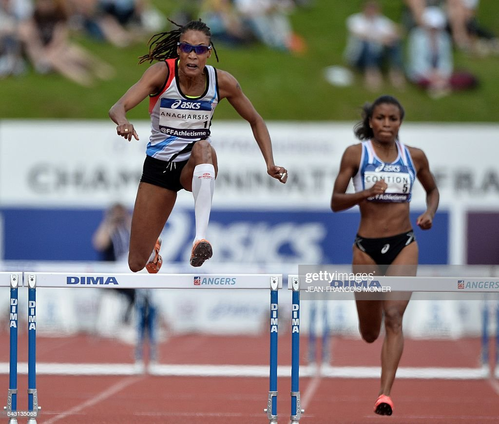 France's Phara Anacharsis (M) competes for the Women's 400m hurdles final next to France's Maeva Contion (R) during the French Athletics Elite championships on June 26, 2016 at the Lac de Maine stadium in Angers, western France. / AFP / JEAN