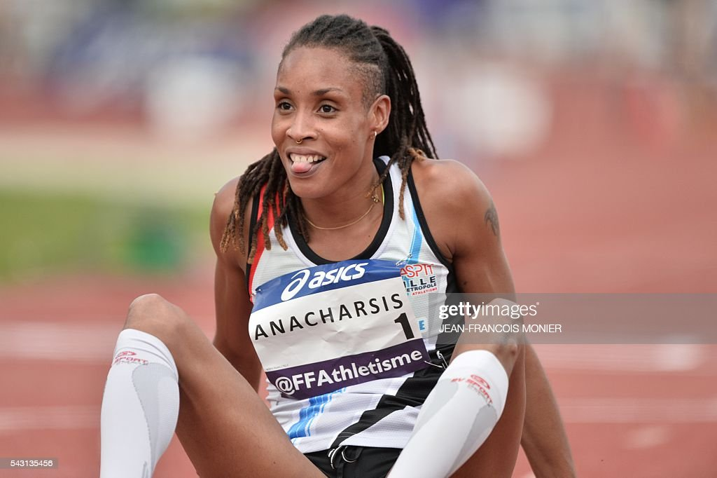 France's Phara Anacharsis reacts after winning the Women's 400m hurdles final, during the French Athletics Elite championships on June 26, 2016 at the Lac de Maine stadium in Angers, western France. / AFP / JEAN