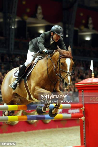 France's Philippe Rozier riding Ideal de Roy wins the Tom Hudson Eraser Stakes at Olympia during the London International Horse Show at Olympia London