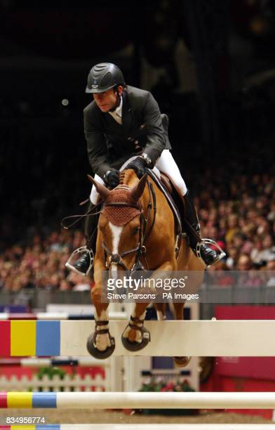France's Philippe Rozier riding Ideal de Roy wins the Tom Hudson Eraser Stakes during the London International Horse Show at Olympia London