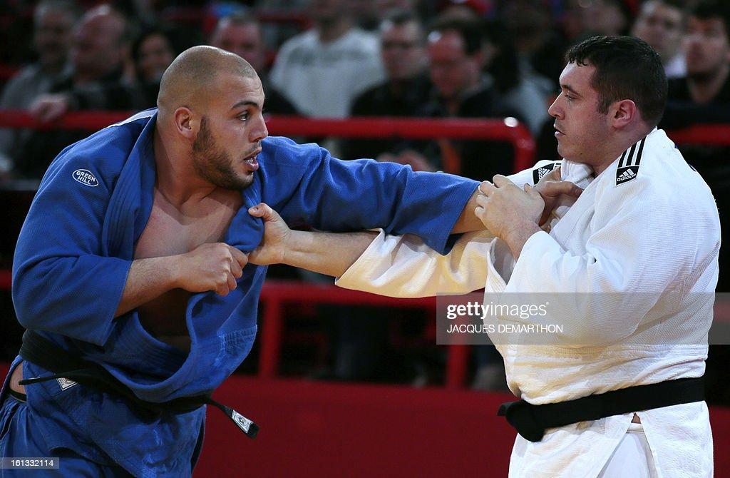 France's Pierre Alexandre Robin (white) fights against Tunisia's Faicel Jaballah (blue) on February 10, 2013 in Paris, during the eliminatories of the Men + 100kg of the Paris Judo Grand Slam tournament.