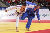 France's Pierre Duprat fights against Georgia's Lasha Shavdatuashvili during the mens qualification match in the 73kg category at the the IJF Judo...