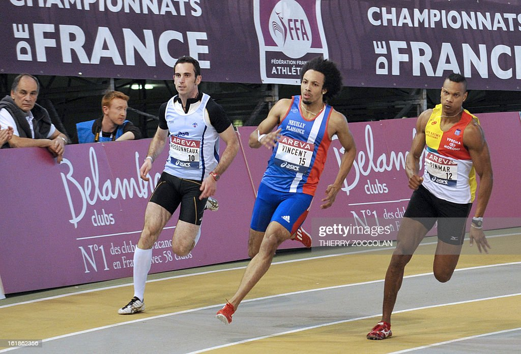 France's Pierre Vincent (C) runs to first place in front of second placed France's Teddy Timar (R) during the men's 200m race of the French Elite Athletics Championships in Aubiere on February 17, 2013.