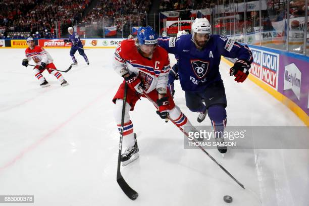 France's PierreEdouard Bellemare vies with Czech Republic's Jakub Voracek during the IIHF Men's World Championship group B ice hockey match between...