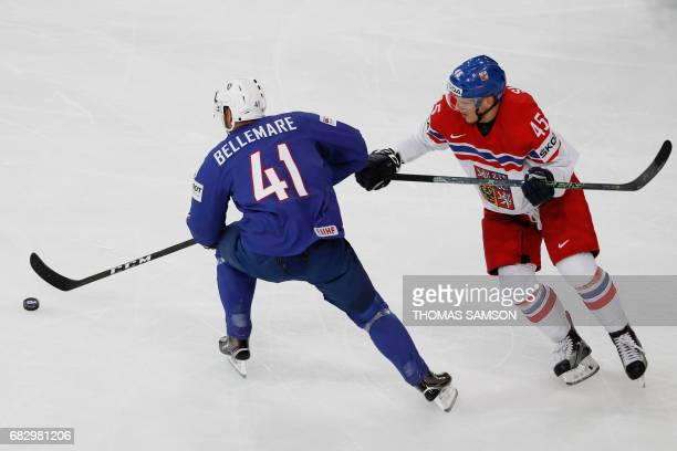France's PierreEdouard Bellemare vies with Czech Republic's Radim Simek during the IIHF Men's World Championship group B ice hockey match between...