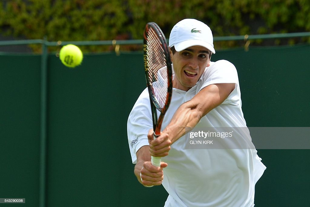 France's Pierre-Hughes Herbert returns against Germany's Philipp Kohlschreiber during their men's singles first round match on the first day of the 2016 Wimbledon Championships at The All England Lawn Tennis Club in Wimbledon, southwest London, on June 27, 2016. / AFP / GLYN