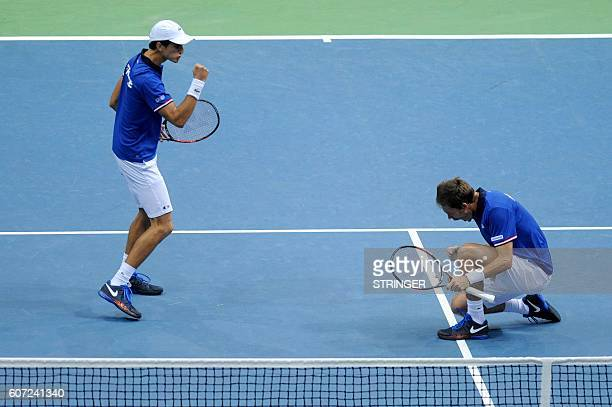 TOPSHOT France's PierreHugues Herbert and Nicolas Mahut celebrate after scoring against Croatia's Marin Cilic and Ivan Dodig during the Davis Cup...