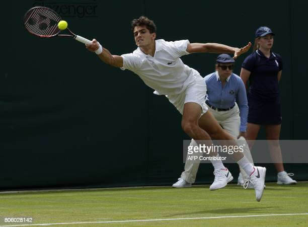CORRECTION France's PierreHugues Herbert returns against Australia's Nick Kyrgios during their men's singles first round match on the first day of...