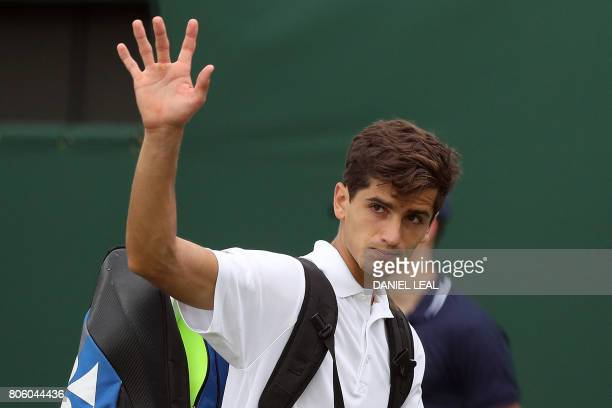 CORRECTION France's PierreHugues Herbert waves to the crowd after winning against Australia's Nick Kyrgios during their men's singles first round...
