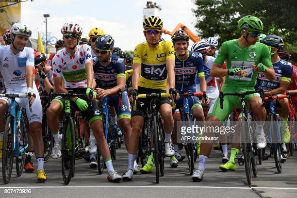 France's PierreRoger Latour wearing the best young's white jersey USA's Nathan Brown wearing the best climber's polka dot jersey Great Britain's...