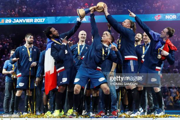 TOPSHOT France's pivot Cedric Sorhaindo France's centre back Daniel Narcisse France's left back William Accambray hold thwe winner's trophy as...